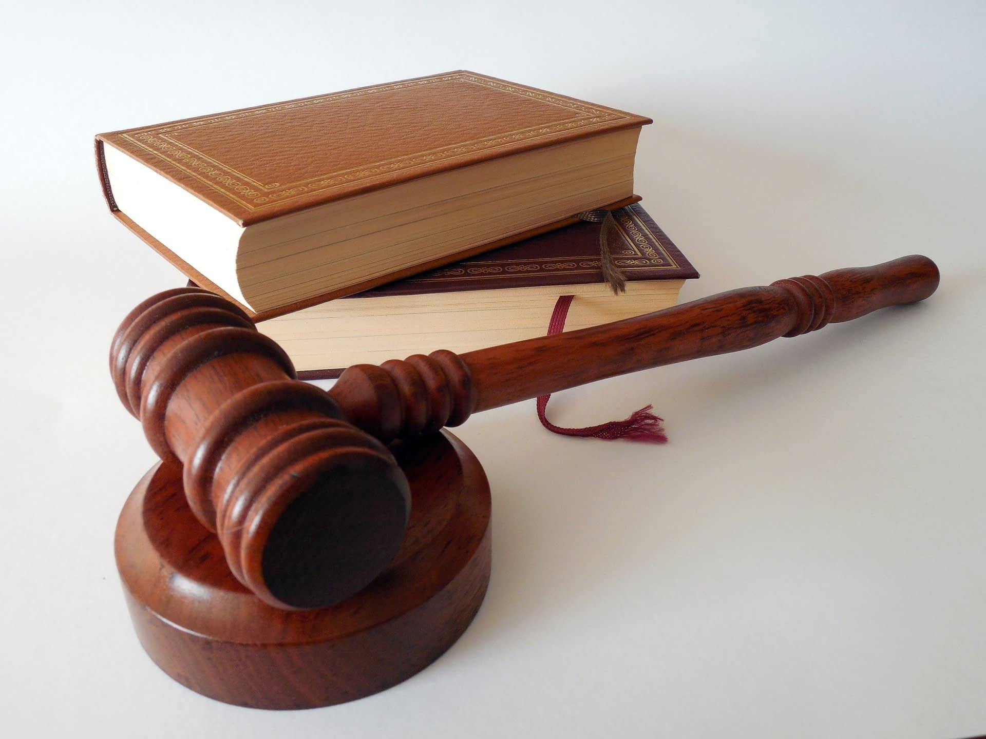 Law gavel with law books